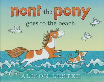 Pony and dog frolicking inthe waves on the cover