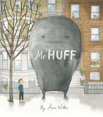 Streetscape with a small boy and a very large Mr Huff