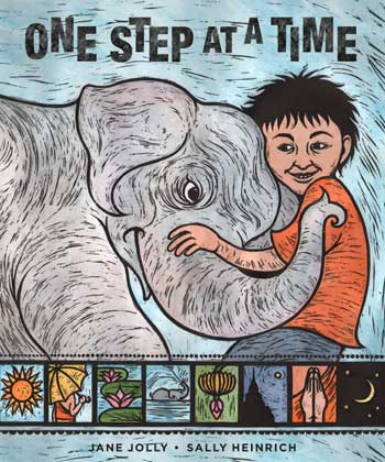 A boy embracing the trunk of a baby elephant on the cover