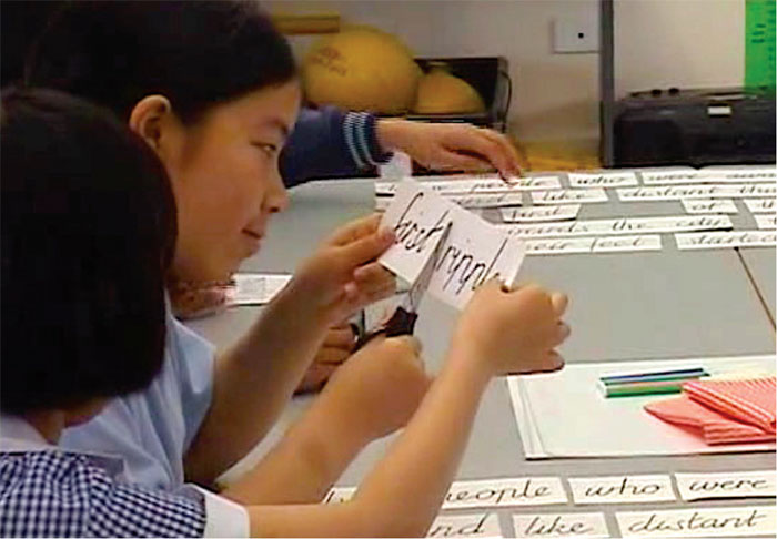 Students reassembling sequences form cuou out word groups