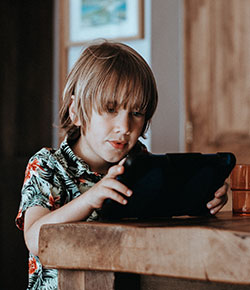 Photo of child with tablet device by Annie Spratt on Unsplash